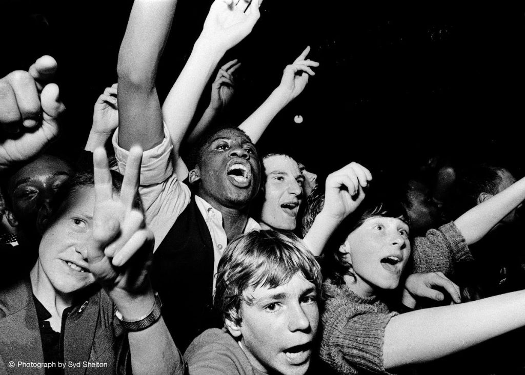 Group of youths at concert.