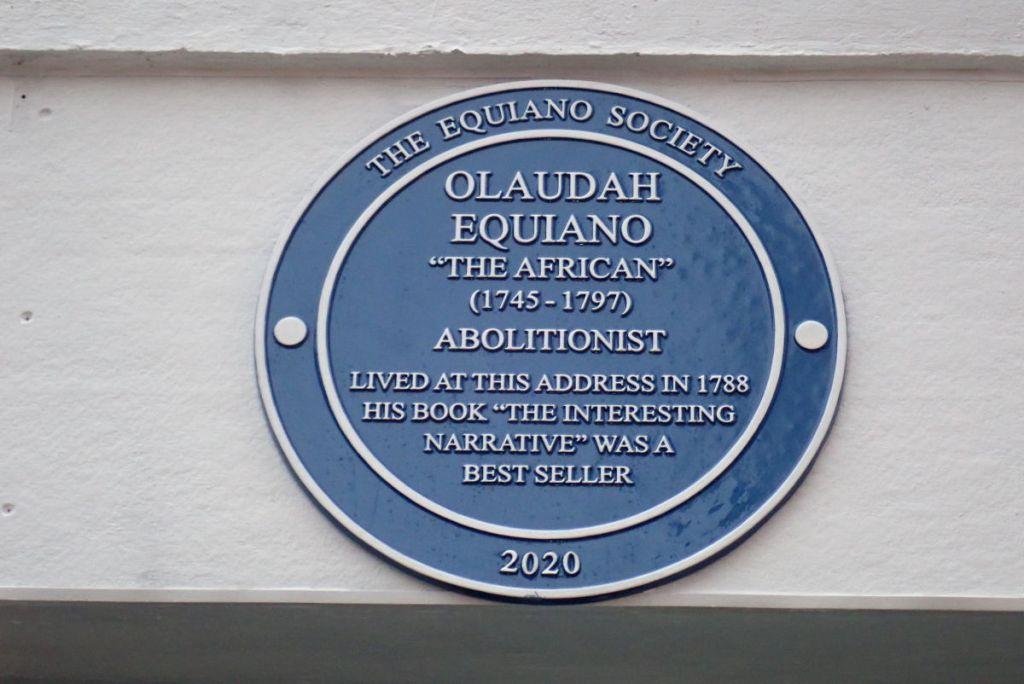 Blue plaque on building.