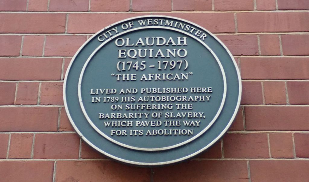 Green plaque on building.