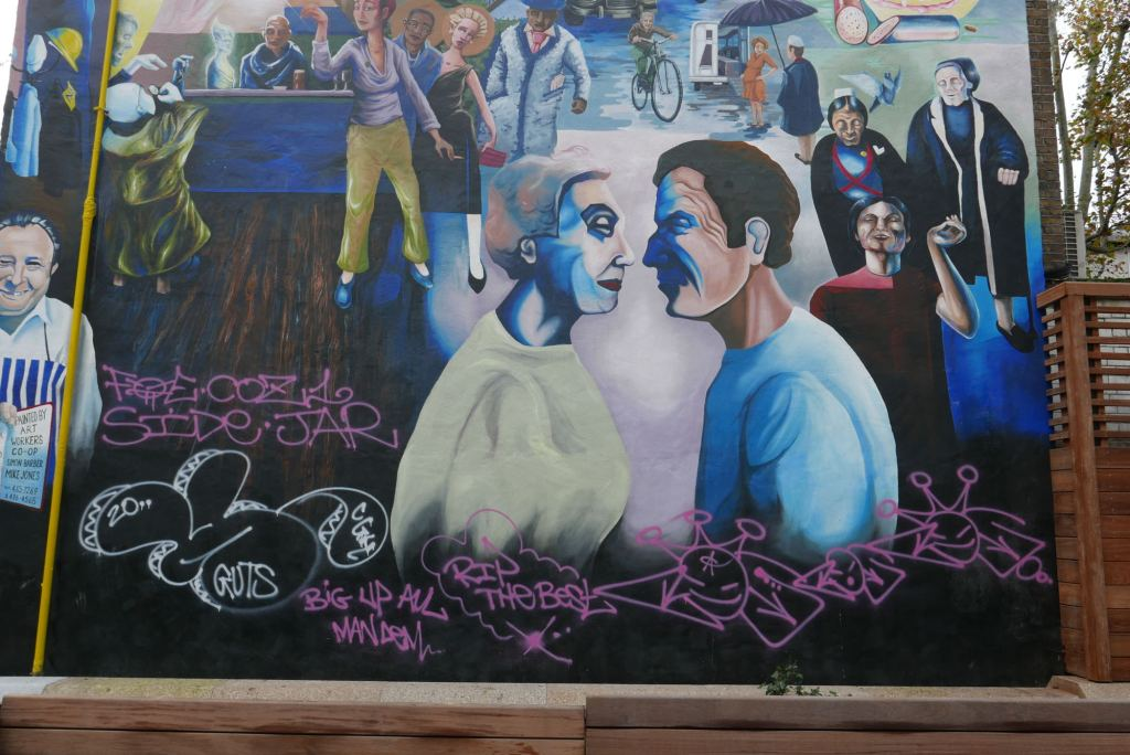 Mural with graffiti.